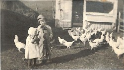 Young Anker and Marion Johnson feed the chickens on the family farm in Solvang.